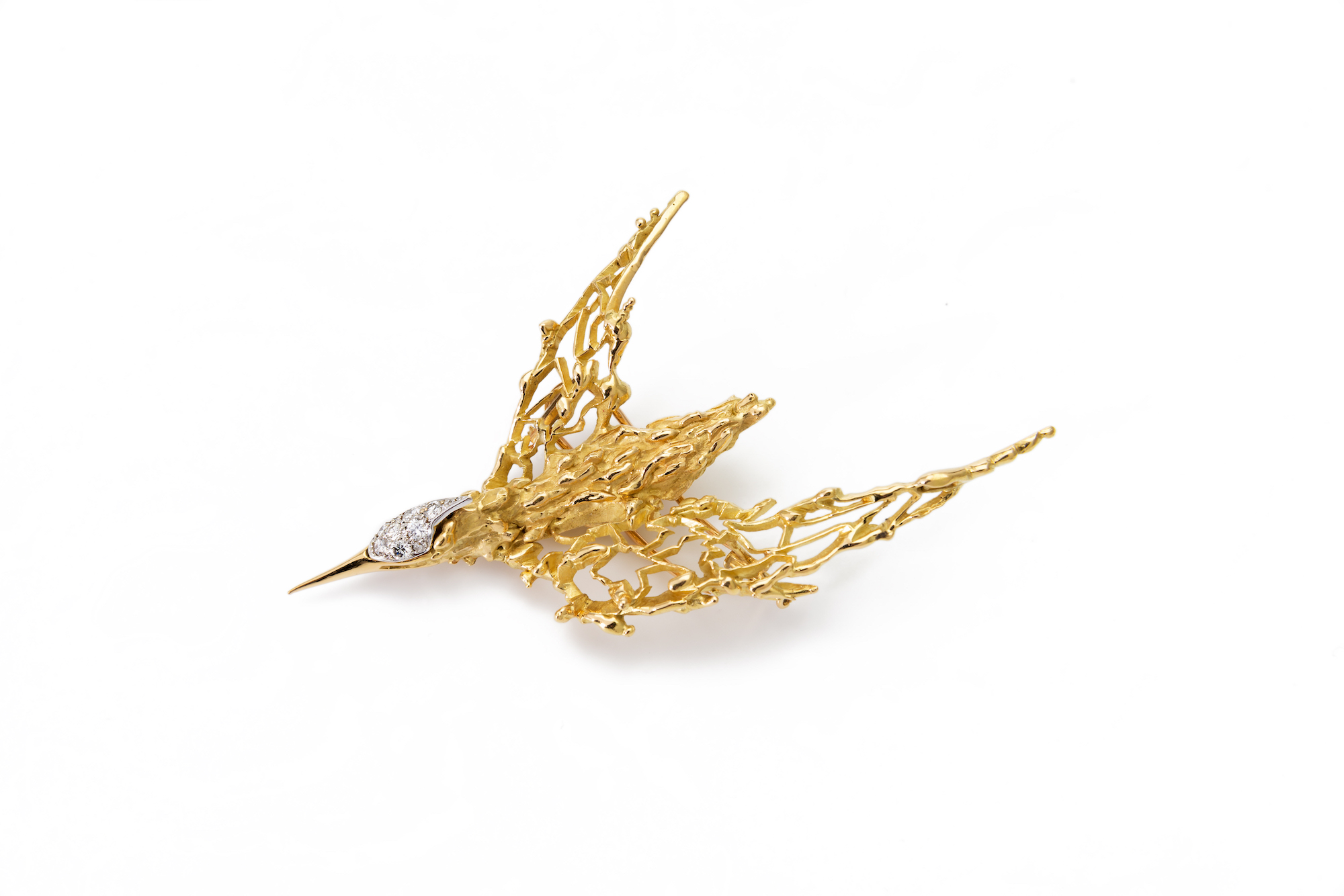 Goldbrosche in form eines fliegenden Vogels